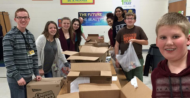 Backpack Buddies lunch bag packing by youth